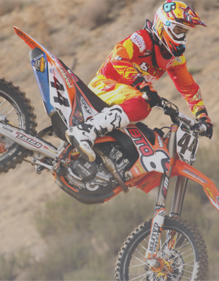 Motocross rider in the air.