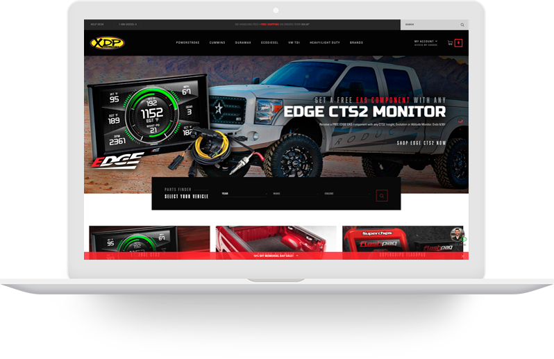Laptop with automotive website displayed.