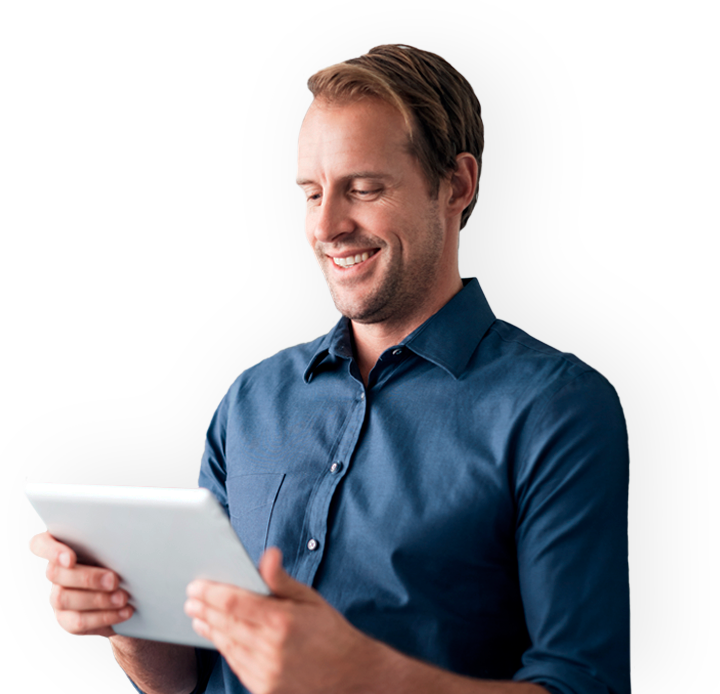 Man using a tablet and smiling.